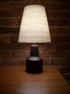 Gorgeous 1960&#039;s ceramic lamp w/original shade designed by Lotte &amp;Gunnar Bostlund - incredible charcoal grey ceramic with a natural jute/fiberglass shade - perfect for a bed side lamp or wherever, these beauties look great anywhere - stands 18&quot; tall - (SOLD
