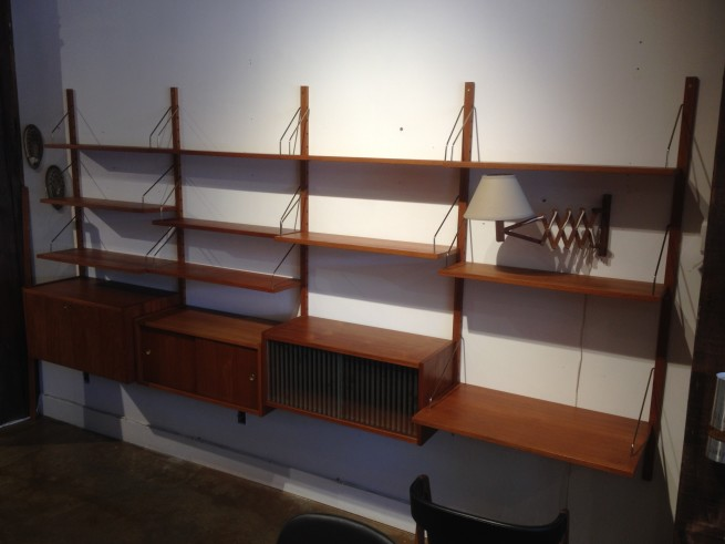 "Outstanding Mid-century Modern teak floating wall system by we believe Peter Sorensen - Made in Denmark - many uses - a bar at one end and a desk at the other - to cabinets have sliding doors to store items and the end piece has a key that opens up to showcase a desk or with letter cubbies - re-arrange to suit... this is just one way to arrange it!!! - fantastic vintage condition with normal wear for it's vintage-126.75""L x 18""D x 59""H - $2000"