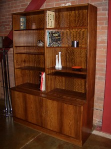 Poul Hundevad 2 piece Rosewood bookcase/display cabinet – exceptional quality – a stunning speciman – all 8 shelves are adjustable on the top half – the cupboard below has 2 adjustable shelves on the right with 3 adjustable little drawers on the left – comes with the original key – both pieces are stamped with the Hundevad marks and the Danish control sticker – excellent vintage condition – measures – 54″W x 12″D x 50.5″H – lower half measures – 17″D x 26.5″H – $1495