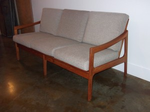"Gorgeous 1960's teak 3 seater sofa - made in Denmark - all new pirelli strapping and fabulous new light grey upholstery - very comfortable - looks great from all angles - 65""L - $1600"