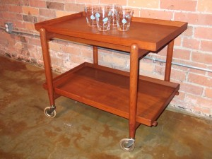 1960′s Danish modern teak bar cart/ serving cart designed by Poul Hundevad – rich dark patina – lovely tongue & groove notching – top expands to double the size – 29.5″L x 20″d x 23.25″H – fully extended = 59″ long $475