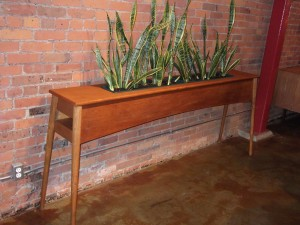 Exceptional Mid-century modern teak/oak planter/ room divider – comes with snake plants – super hardy – low maintenance – SUPER RARE FIND!! – this beauty measures – 87″L x 13.5″D x 35.5″H – (SOLD)