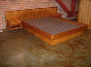 "Spectacular Danish teak platform bed - Queen size - high quality, except the base, which is average - side rails are solid wood, parts of the headboard and end tables - very good condition - a couple minor chips in the base at the foot of the bed - definitely one of the better quality platform beds of this era - measures - 102""width x 85"" L x 28.5""H - (SOLD)"