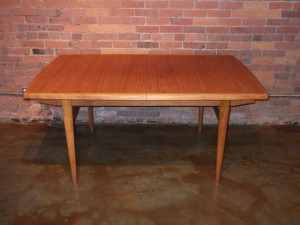 "Handsome Mid-century teak dining table - comes with 2 leaves - fully extended seat 10 - quality craftsmanship - newly re-finished - this beauty measures 65.5""L x 41.25""D x 29.25""H fully extended = 101.5""L - (SOLD)"