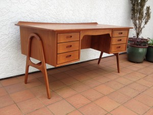 Outrageously fabulous 1960's teak executive desk designed by Architect Svend & Madsen - crazy sexy legs - dovetailed drawers - nice curved lip and a bookcase on the back side - perfect the middle of a room - stamped at base with architect info - made in Denmark - $2200