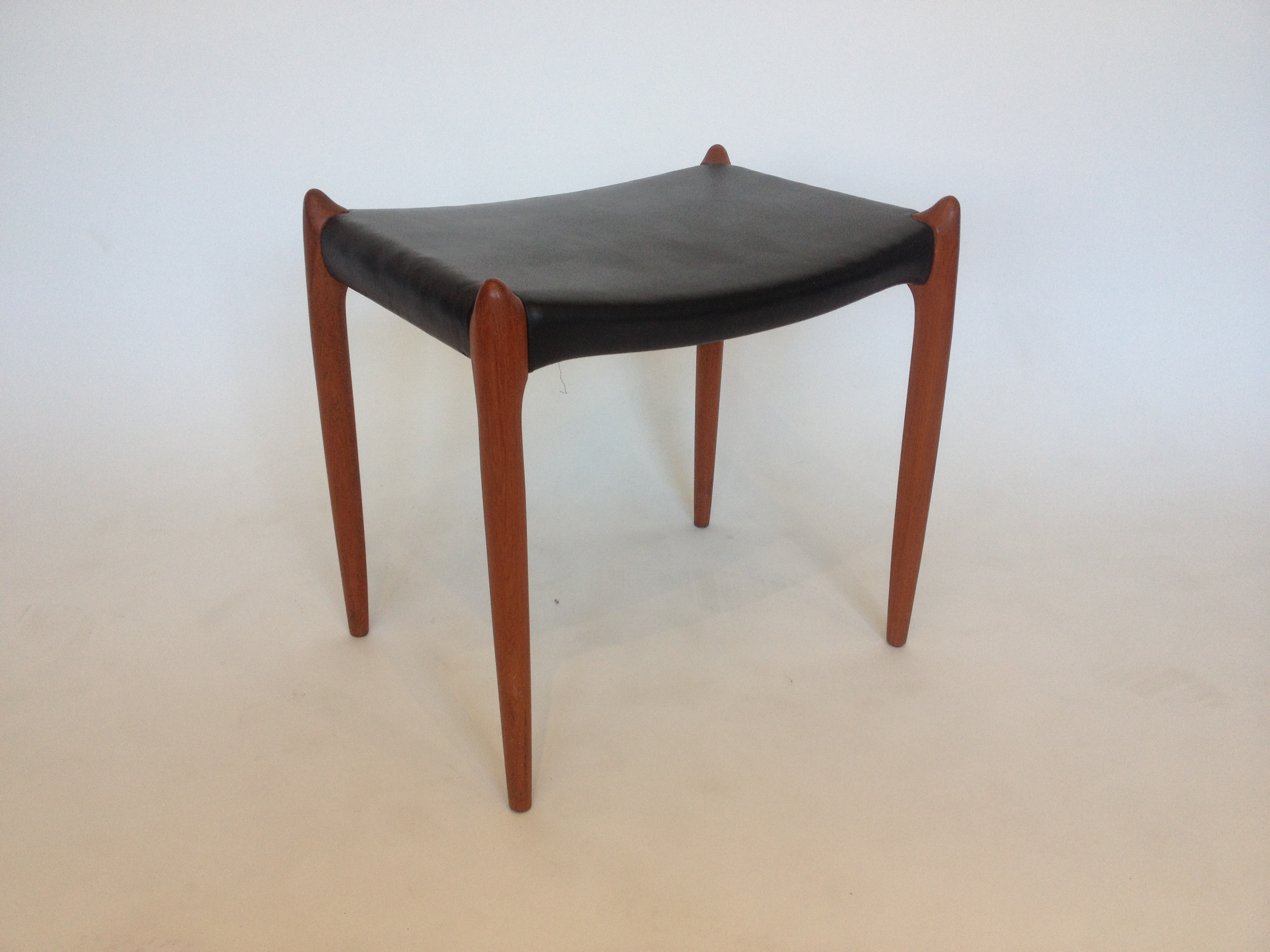 Incredibly Sculptural Early 1960 s teak foot stool  ottoman Designed by  Niels Moller for J L  Moller. The Fabulous Find   Mid Century Modern Furniture Showroom in