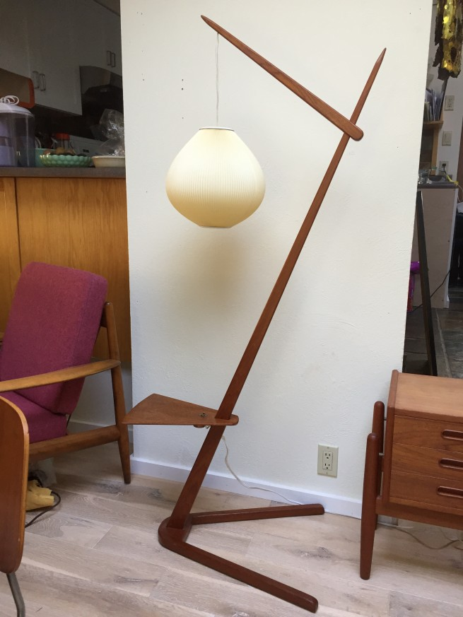 Architecturally interesting teak 1960's floor lamp with an original Le Klint shade.Local pick-up only $1,000.00