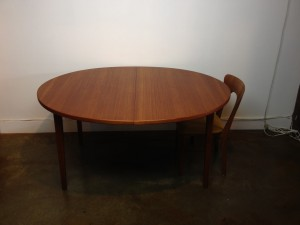"Gorgeous Scandinavian Oval teak dining table - comes w/2 leaves -quality craftsmanship - note the unique middle leg that drops down when fully extended - newly re-finished - 58.5""diameter each leaf is 19.75""L fully extended - 98'L - (SOLD)"
