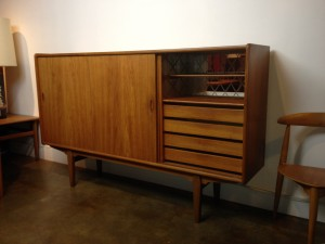 "Fantastic Mid-century teak credenza - fabulous features - right side door reveals a small shelf w/back glass & 4 lovely dovetailed drawers - perfect bar :) the middle and left sliding door reveal one long shelf - it also boasts a super cool leg structure - very good vintage condition - 72.5""L x 16.5'D x 44""H - (SOLD)"