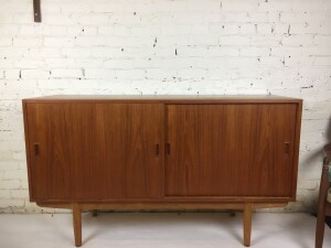 "Exceptional Mid-century Modern sideboard designed by Borge Mogensen for Soborg -comprised of teak - with oak base and beech interior - quality craftsmanship -even the door runners are solid wood as are the shelves... everything is top tier - 59""L x18""D x 34.5""H - (SOLD)"