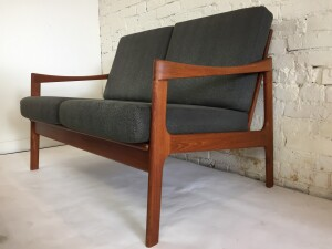 Handsome Mid-century Modern 2 seater loveseat by Oscar Grann - Made in Canada - North Vancouver - circa 1960's very stylish - would look amazing in any modern environment - the solid teak frame has been newly re-finished - recently all the straps have been redone with high quality straps by pirelli - ( the best quality) and the foam and fabric have been redone in recent past :) - (SOLD)