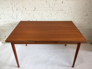 """Gorgeous 1960's Scandinavian Modern teak draw-leaf dining table - newly refinished and ready for your dining pleasure - expands as you have more company - nicely tucks under the table for super clever storage :) - this beauty measures - 51""""L x 34""""D x 29.5""""H - fully extended - 88""""L $1375"""