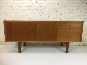 """Exceptional Mid-century Modern teak sideboard designed by Lennart Bender for Ulferts , Sweden - this beauty has many amazing features, for starters it has a gorgeous finished back so you can use it as a roomdivider, it has craftmanship dovetailed drawers, a secret extra flatware drawer inside the top drawer ... it has rosewood hand carved drawer pulls and doors ... this beauty has been newly refinished and ready for it's new home - 64""""L x 18""""D x 28""""H -(SOLD)"""