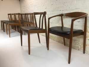 Exquisite set of 8 Mid-century Modern dining chairs comprised of 7 side chairs and 1 arm chair - comfortable and design forward - excellent vintage condition -