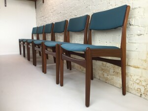 Gorgeous Set of 6 Danish Modern 1960's dining chairs designed by Poul Volther for Frem Rojle - Made in Denmark - these beauties have been recently re-upholstered in a durable gorgeous blue fabric that looks dynamite with the dark solid wood frame - $3000 /set