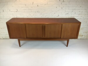 """Outstanding Mid-century Modern teak sideboard by Danish Company H.P.Hansen - high quality craftsmanship - from the bow front , to the dovetailed drawers front and back, the smooth sliders, perfect for grounding any room in need of function, quality and beauty , it is in excellent condition - it measures - 78.5""""L x 20"""" at it's widest point in the bow front x 31""""H (SOLD)"""