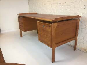 """Handsome 1960's teak desk by G.V.Gasvig - Denmark - it has so many fabulous features, one being a completely finished back, so perfect for floating in the middle of a room if you have the space available , 3 dovetailed drawers and the oh so handy file drawer - lovely patina - this beauty measures - 59""""L x 29.5""""D x 28""""H (SOLD)"""