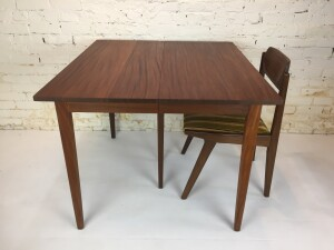 """Absolutely Stunning Mid-century Modern solid African teak dining table Designed by Jan Kuypers for Imperial Furniture - Toronto, Canada - use it as a compact size table with no leaves or use one leaf for 6 or 2 for 8 or 3 leaves to seat 10 - notice the center leg structure for full expansion - newly refinished - this incredible table measures - 36"""" x 40"""" x 29.25""""H - fully extended - 96.75""""L -(SOLD)"""