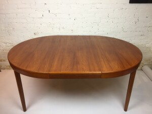 """Spectacular Mid-century Modern circular teak dining table - unique legs that add an immense design element to this gorgeous newly refinished table - quality craftsmanship - comes with 2 leaves - shown with one --47"""" diameter x 28.5""""H each leaf - 19.5"""" - (SOLD)"""