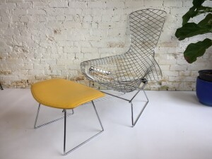Bird Chair and footstool by Harry Bertoia for Knoll 1960's We left the old cover on the footstool to show the original Knoll, Park Ave New York label. This chair is a astounding study in space, form and function by one of the master sculptors of the last century. $1,300