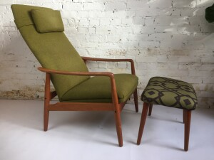 A super comfortable vintage high-back reclining lounge chair and ottoman designed by Svend Langkilde for SL Mobler Denmark. The lounge chair has a sculpted solid teak frame - the chair reclines manually- recently re-upholstered - (SOLD)