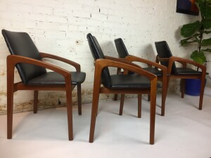 Handsome Set of 4 Mid-century Modern teak dining chairs designed by Kai Kristiansen - a chair you can kick back in after dinner :) you know what I'm talking about - a couple of the chairs have some cat claw marks in the naugahyde, but we priced them accordingly so you could have them redone if need be :) - (SOLD)