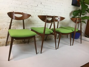 Incredibly unique set of 4 Mid-century Modern walnut dining chairs - spectacular features include - super fly splayed legs - the curve in the back rest is just right - these chairs are incredibly comfortable, a must try - the seats were recently re-upholstered but do have a few small stains - use as is or redo to suit your own taste - comes with the matching oval table - see pic in next post -Table and chair set - (SOLD)