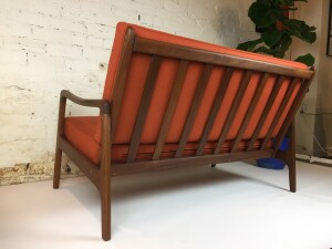 Spectacular Mid-century Modern 1960's solid teak love seat -newly restored - looks like new - new foam, upholstered in a gorgeous burnt orange soft wool and the solid teak frame has been newly refinished and looks absolutely stunning -(SOLD) check out the matching chair with a gorgeous complimentary earthy green wool fabric(SOLD)