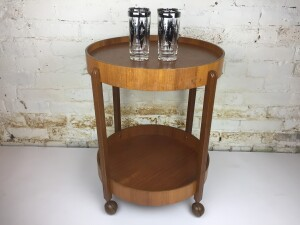 """Fabulous Vintage 2 tier circular teak bar cart comprised of teak veneer and walnut - perfect for holiday entertaining or really for anytime of the year :) 18"""" d x 23""""H (SOLD)"""