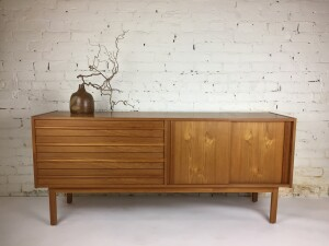 """Handsome Mid-century Modern teak sideboard in comprised of 4 dovetailed drawers on the left and 2 sliding doors on the right ( in behind them is one adjustable shelf ) a lovely smaller size - great vintage condition - measures 63""""Lx 15.75""""D x 27.5""""H - (SOLD)"""