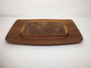 Gorgeous Design by Jens Quistgaard for Dansk, this large teak cutting board/ cheez board has a center section of staved teak to hold a cheez or two and a recessed area around the rim for crackers and fruit etc... stunning wood grain with rich patina, In good vintage condition(SOLD)