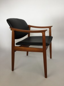 Husband and Wife team Tove and Edvard Kindt-Larsen designed teak armchair, produced by France & Daverkosen - Denmark - circa 1950's This armchair features a beautifully engineered brass connector on the back which allows it to 'float' above the seat - this beauty is 100% original with a newly refinished solid teak frame(SOLD)