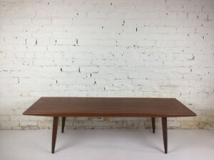 Spectacular Mid-century Modern teak coffee table - lovely features - splayed legs tapered edge along the front and back - this beauty is in fantastic original condition -(SOLD)