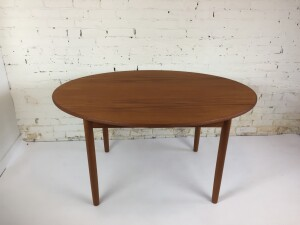 """Unique, quality 1960's Scandinavian Modern Oval teak dining table that has a built in butterfly leaf that creates an unusual shape - newly refinished - 54""""L x 39""""D x 28.5""""H fully extended - 57