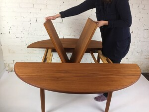 """Unique, quality 1960's Scandinavian Modern Oval teak dining table that has a built in butterfly leaf that creates an unusual shape - newly refinished - 54""""L x 39""""D x 28.5""""H fully extended - 57""""D (SOLD)"""