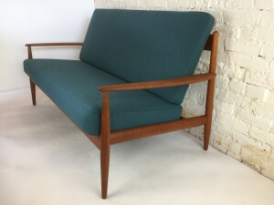 """Danish teak sofa by renowned Danish company France and Son - early 1960's - this beauty retains the original box spring cushions for a superior comfort and has been reupholstered in a stunning high quality fabric by Kvadrat in teal blue - measures - 62""""L x 30""""D x 17.5""""SH x 32""""BH -(SOLD)"""