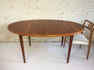 Incredible beautiful and unique Danish teak oval dining table - newly refinished - comes with 2 leaves - seats up to 8 - measures -(SOLD)