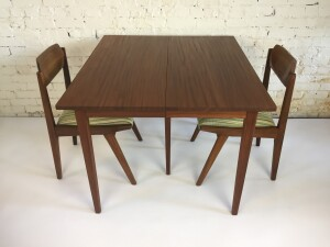Gorgeous Mid-century Modern solid teak dining table - designed by Jan Kupyers for Imperial - Canada -comes with 3 leaves and extended double leg in the center when extended for support - newly re-finished and looked incredible -(SOLD)