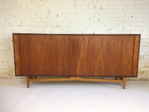 """Handsome Mid-century Modern teak and oak tambour door bar cabinet /sideboard - this beauty boasts adjustable shelving ont both sides and the center has a pullout black melamine tray for mixing your drinks at the top and below that there is a pullout drawer for your drink accessories jiggers/spoons - corkscrews etc... and the bottom drawer pulls out and is partitioned off to hold 9 bottles - measures - 71.5""""L x 18""""D x 33.25""""H (SOLD)"""