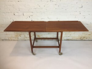 An exceptional Mid-Century Modern expandable teak serving /bar cart Designed by Poul Hundevad, - Made in Denmark - very nice vintage condition - (SOLD)