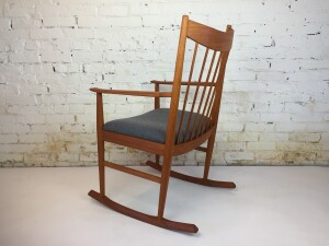 Gorgeous Danish teak rocking chair designed in the 1960's by Arne Vodder for Sibast - Denmark - with it's curved spindle back and a drop in seat it makes for a very comfortable seating experience - Arne Vodder (1926-2009) was a Danish architect and designer who trained under Finn Juhl, a leading exponent of 'Danish Design'. - the solid teak frame has been professionally re-finished and the seat re-upholstered in a lovely soft medium grey wool - $1500