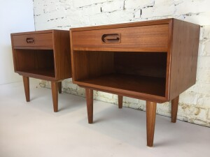 Handsome early 1960's teak bedside tables by Dyrlund - Made in Denmark - excellent quality craftsmanship - incredible dark rich patina - dovetailed drawers - see matching highboy dresser and bedside tables - 4 pieces sold together as a set -