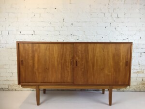 """Outstanding Mid-century Modern teak sideboard on raised oak base - Designed in 1954 by Borge Mogensen for Soborg Mobelfabrik - Made in Denmark - very high quality - the craftsmanship is really outstanding on this beauty - the interior to the right has 4 adjustable dovetailed drawers that you can place to suit and the left side has shelf - this incredible piece has been completely refinished - measures - 59""""L x 18""""D x 34.25""""H - (SOLD)"""