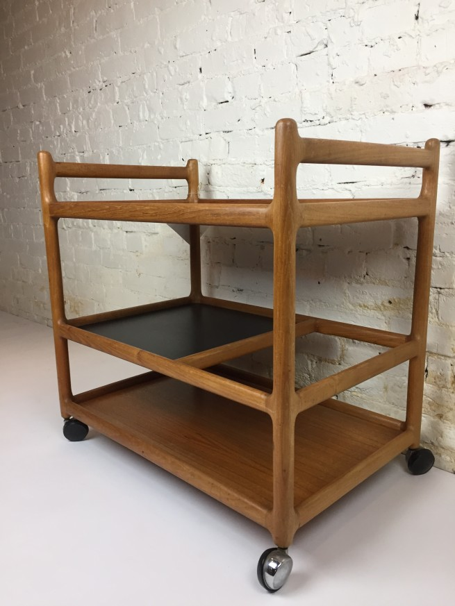 Exquisite Mid-century Modern serving cart designed by Johannes Andersen for CFC Silkeborg - made in Denmark in the 1960's - this bar cart is comprised of solid teak with a black laminate tray and smooth rolling castors - incredibly well made with an eye for detail in the design -(SOLD)