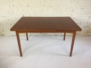 """A Gorgeous teak draw-leaf dining table Designed by Tage Olofsson for Ulferts of Sweden. Produced in the 1960's - newly refinished - sleek design - this beauty measures - - 53""""L x 33.25""""D x 29.25""""H (SOLD)"""