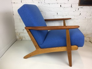 Quality 1950's completely restored Danish chair with new foam, and very durable Maharam fabric - this beauty is comprised s exquisite combination of contrasting woods - teak oak $1,450