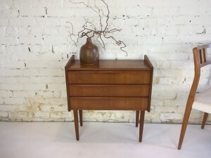 """Handsome 1960's small teak chest of drawers - unique design - this beauty would look great in an entry way with a mirror and chair, or beside your bed, or even in your office with your printer on top storage for your papers etc... -good vintage condition -d vintage condition - 24.5""""W x 11.5""""D x 27""""H - $250"""