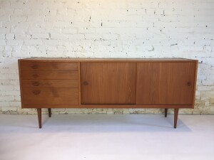 """A beautiful and functional teak sideboard designed by Kai Kristiansen for Feldballes Mobelfabrik - model FM-170 - 1958 Made in Denmark - note the signature """"eye"""" shaped pulls, so fabulous - dovetailed wood drawers and adjustable shelving behind each door - spectacular original patina - would be fabulous used as a media unit for your television or record player - measures 71""""L x 17.5""""D x 29""""H (SOLD)"""