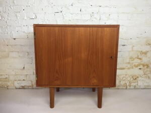 Fantastic Mid-century Modern teak cabinet by Hundevad & Co. Made in Denmark - excellent quality craftsmanship -think stereo, media , extra storage in any room - office - newly refinished - (SOLD)