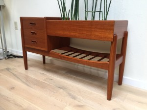 "Outstanding Danish modern teak planter features a chest of three drawers on the left and a low slated magazine shelf under the planter area - Designed by Arne Wahl Iversen for Vinde Mobelfabrik, stamped circa 1960s - this beauty is gorgeous from every angle, finished on all sides - 38""L x 13""""D x 22""H - (SOLD)"